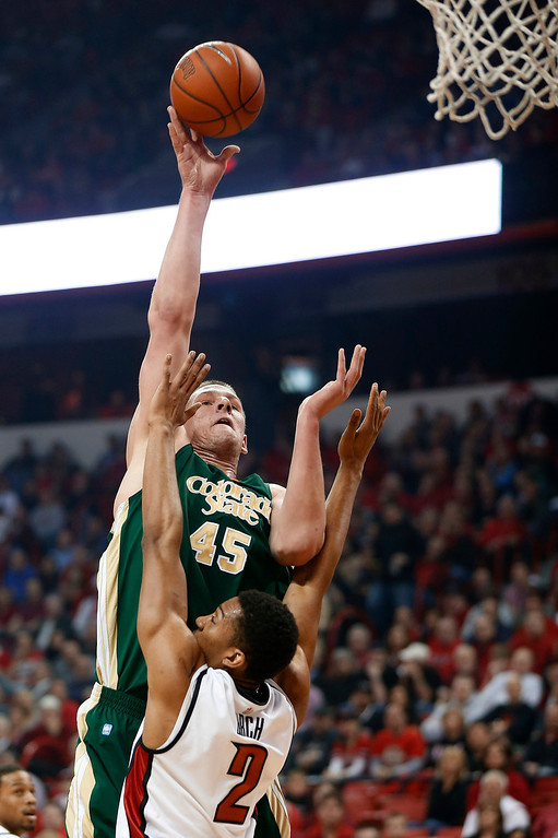 . Colorado State\'s Colton Iverson shoots over UNLV\'s Khem Birch during the first half of an NCAA college basketball game Wednesday, Feb. 20, 2013, in Las Vegas. (AP Photo/Isaac Brekken)