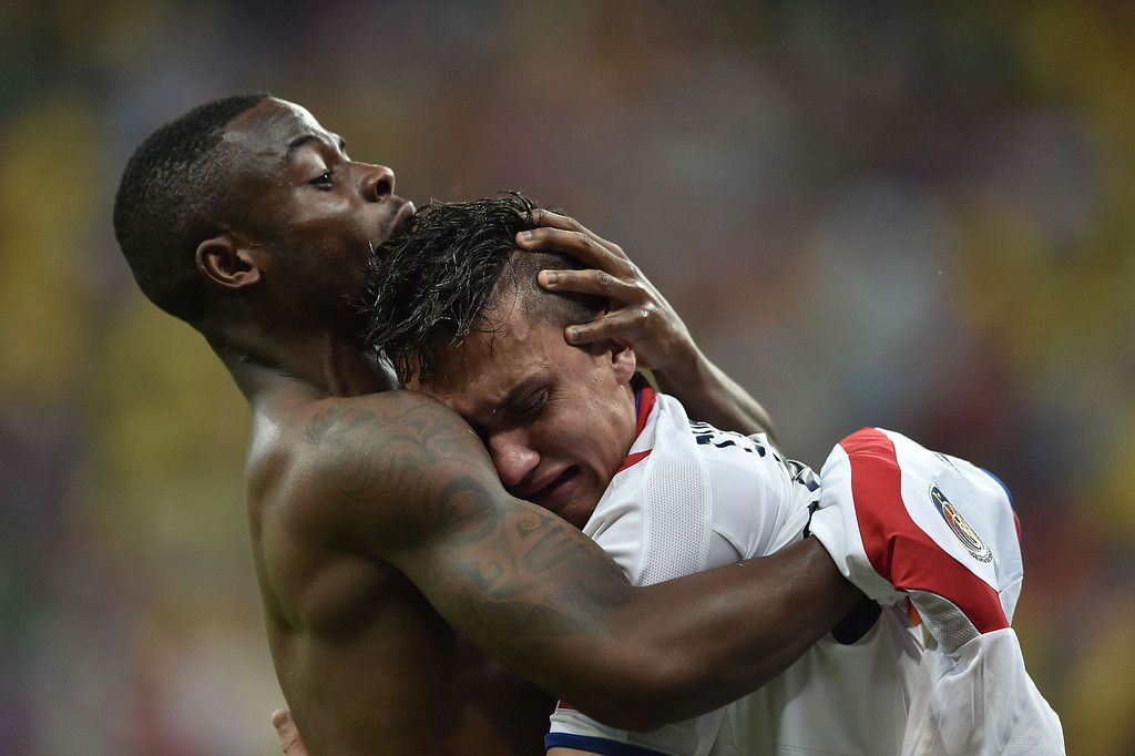 . Costa Rica\'s defender Waylon Francis (L) and Costa Rica\'s midfielder Jose Miguel Cubero celebrate after winning a Round of 16 football match between Costa Rica and Greece at Pernambuco Arena in Recife during the 2014 FIFA World Cup on June 29, 2014.     ARIS MESSINIS/AFP/Getty Images