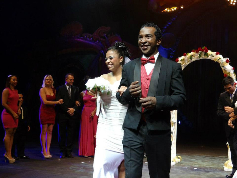 ". Ringling Bros. performers Daniele and Andre McClain walk down the ""aisle\"" at their surprise circus wedding at the Denver Coliseum on Oct. 2, 2012. Ringling Bros. photo"