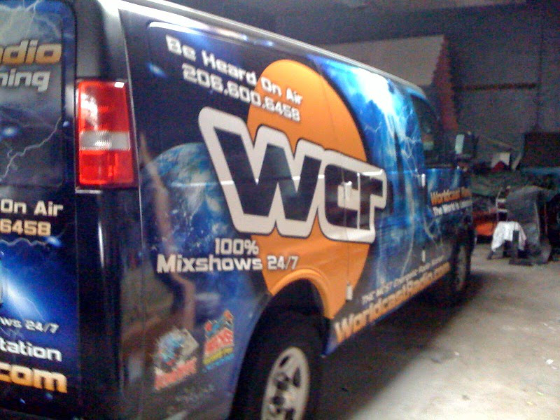 Vehicle wrap on a Chevy Express Van for World Cast Radio in New York, NY.  http://www.skinzwraps.com
