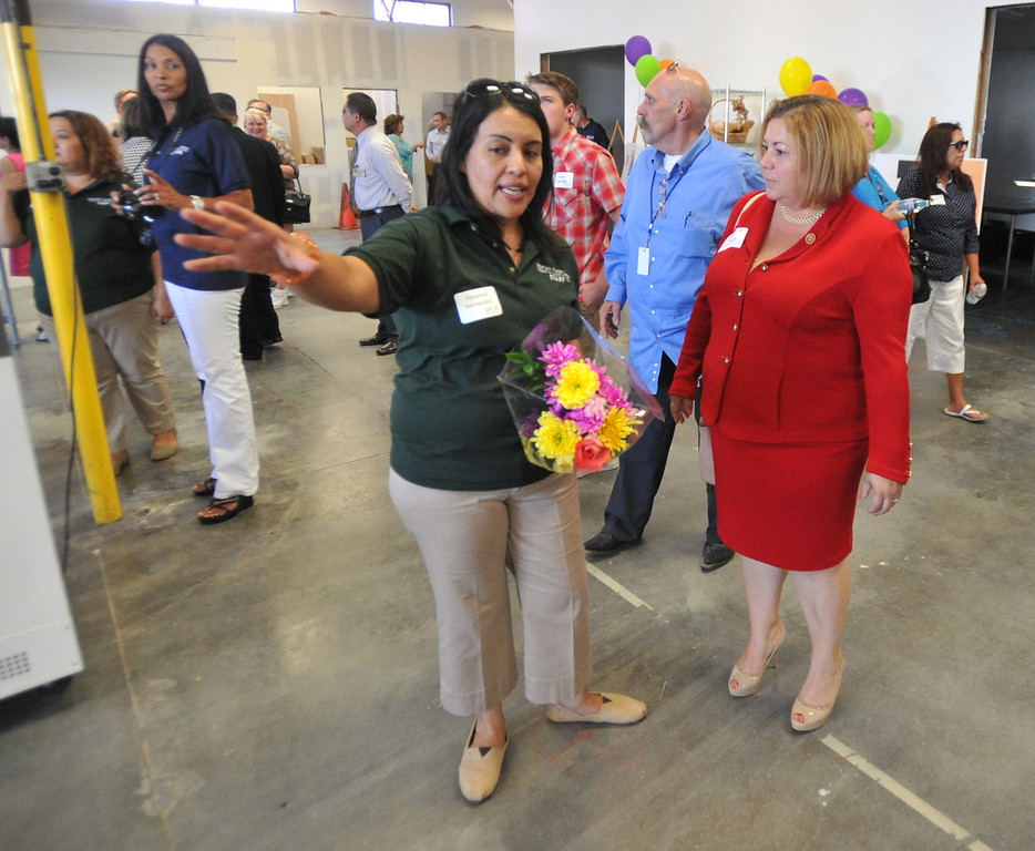 . Veronica Hernandez shows Congresswoman Linda Sanchez around their new location at the Interfaith Food Center in Santa Fe Springs on Wednesday August 21, 2013. The Interfaith Food Center is a non-profit, previously located in unincorporated Whittier for 30 years, providing food services to the neediest residents of Whittier and La Mirada.