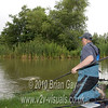 Brian Gay neils to land a carp at Burton Springs Carp Lake, Burton, Somerset. v