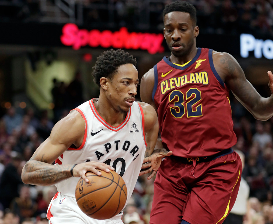 . Toronto Raptors\' DeMar DeRozan (10) drives against Cleveland Cavaliers\' Jeff Green (32) during the first half of an NBA basketball game Wednesday, March 21, 2018, in Cleveland. (AP Photo/Tony Dejak)