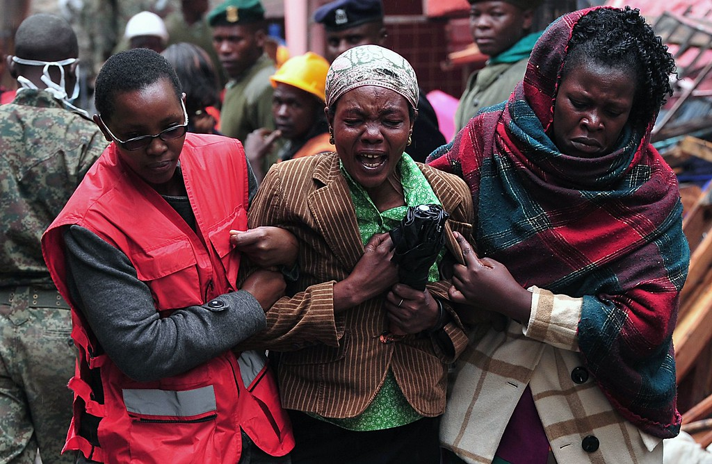 . A Kenyan woman mourns the loss of a relative at the site of a building collapse in Nairobi on April 30, 2016. Rescuers in the Kenyan capital made desperate efforts to free survivors including a woman and child trapped in a building that collapsed in storms that have left a total of 17 people dead. / AFP PHOTO / SIMON  MAINA/AFP/Getty Images