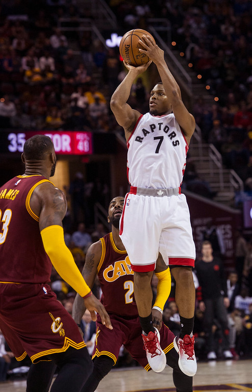 . Toronto Raptors\' Kyle Lowry (7) shoots over Cleveland Cavaliers\' LeBron James (23) during the second half of an NBA basketball game in Cleveland, Tuesday, Nov. 15, 2016. The Cavaliers won 121-117. (AP Photo/Phil Long)
