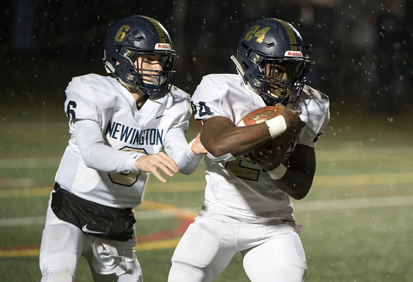 11/27/19 Wesley Bunnell | StaffrrNewington football vs Wethersfield on Wednesday evening at Wethersfield High School. QB Nicholas Pestrichello (6) hands off to RB John Amaning (24).