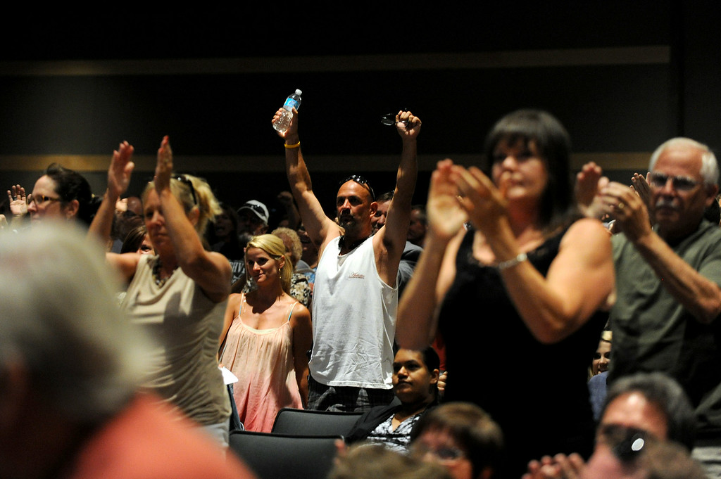 . The audience stands and cheers after Chairman of the Board Supervisor Jeff Stone finished speaking during a town hall meeting on Wednesday, July 2, 2014 at Murrieta Mesa High School in Murrieta, Ca. The meeting is being held in response to immigrants who were being processed through a Texas Border Patrol Station and delivered to the Murrieta Border Patrol Station on Tuesday, which created protests from both sides of the immigration issue. (Micah Escamilla/The Sun)