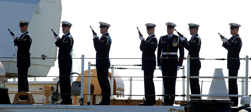 . An honor guard fires a 21-gun salute during a memorial service for U.S. Coast Guard Boatswain\'s Mate Third Class Travis R. Obendorf, Thursday, Jan. 30, 2014 on Coast Guard Island in Alameda, Calif. Obendorf suffered fatal injuries while performing his duties aboard the Coast Guard Cutter Waesche as part of a search and rescue off the coast of the Alaska in November 2013. (D. Ross Cameron/Bay Area News Group)