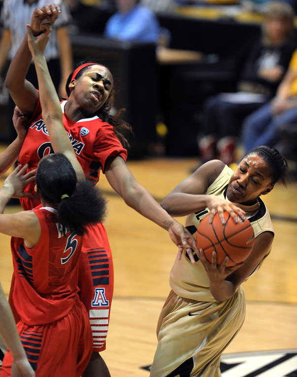 . Kyleesha Weston, right, of Colorado, gets a rebound from Davellyn Whyte of Arizona during the first half of the  NCAA Womens Basketball  game in Boulder Sunday Jan. 20, 2013.  Cliff Grassmick/The Daily Camera