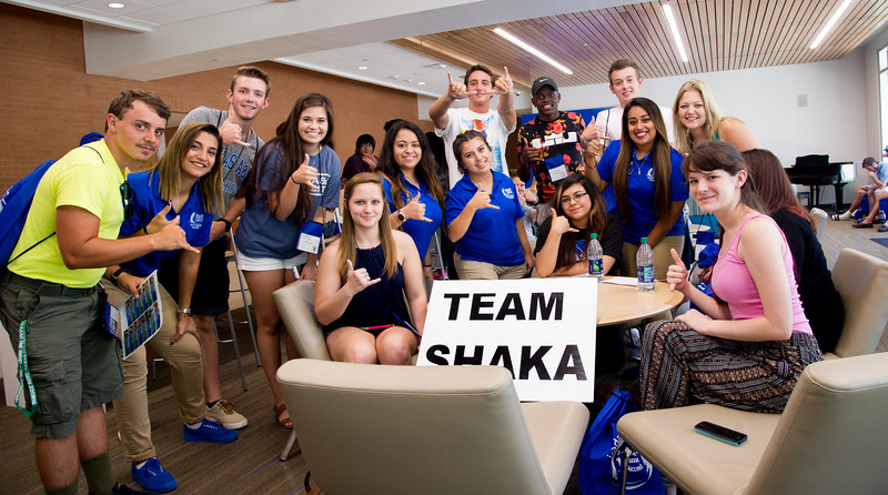 Orientation team shaka shows their school pride in the Tejas Lounge area.