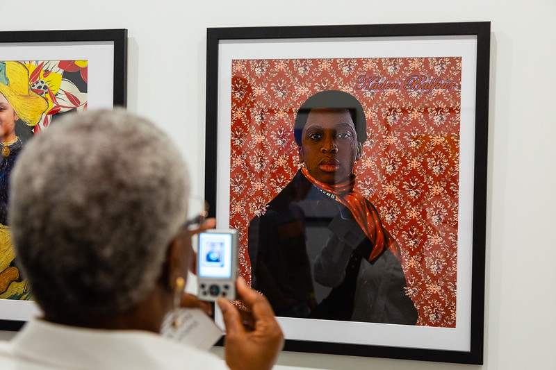 Bertha Corbin of Riviera Beach photographs a piece of artwork by Kaden Balfour of Polo Park Middle School during the grand opening of the Norton Museum of the Arts on Saturday, February 9, 2019. [JOSEPH FORZANO/palmbeachpost.com]