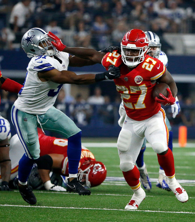 . Kansas City Chiefs running back Kareem Hunt (27) fights off a tackle attempt by Dallas Cowboys safety Byron Jones (31) in the second half of an NFL football game, Sunday, Nov. 5, 2017, in Arlington, Texas. (AP Photo/Michael Ainsworth)