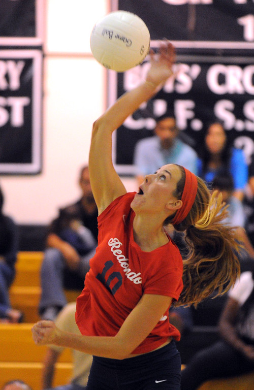 . Redondo girls volleyball takes on Bishop Montgomery in a non league match in Torrance on 09/10/2013. Redondo won 3-0. Redondo\'s Marissa Mitter spikes from midcourt. (Photo by Scott Varley, Daily Breeze)