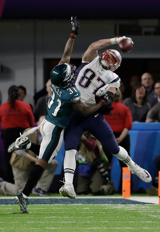 . Philadelphia Eagles cornerback Jalen Mills (31) breaks up a pass intended for New England Patriots tight end Rob Gronkowski (87), during the first half of the NFL Super Bowl 52 football game, Sunday, Feb. 4, 2018, in Minneapolis. (AP Photo/Chris O\'Meara)