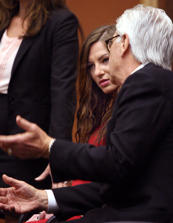 . Alix Tichelman hears the gameplan from her attorney Jerry Christiansen in court Tuesday before she pleaded guilty for her part in the heroin death of Google executive Forest Hayes on his boat in the Santa Cruz Harbor.  Tichelman got six years in jail but will serve only half that.  (Dan Coyro -- Santa Cruz Sentinel)