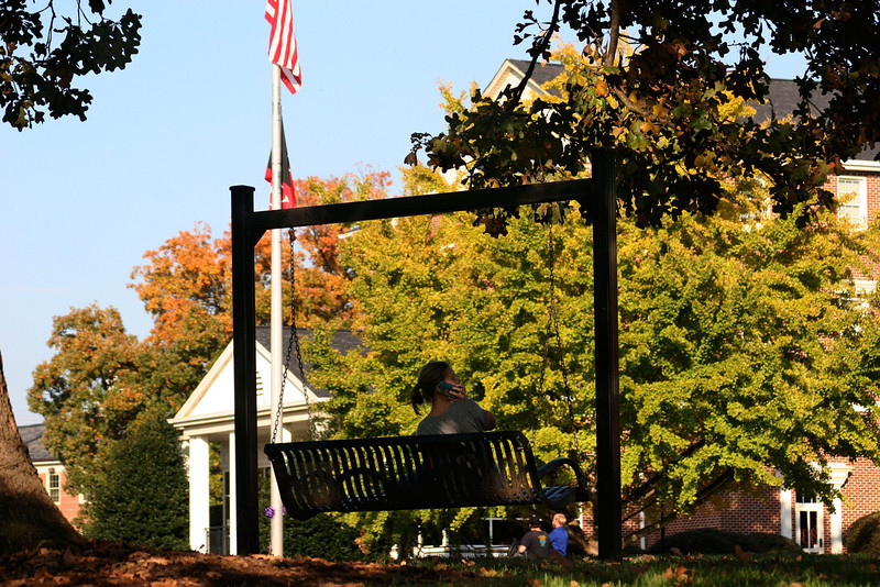 A Gardner-Webb University student sitting in the quad on a beautiful Fall day.