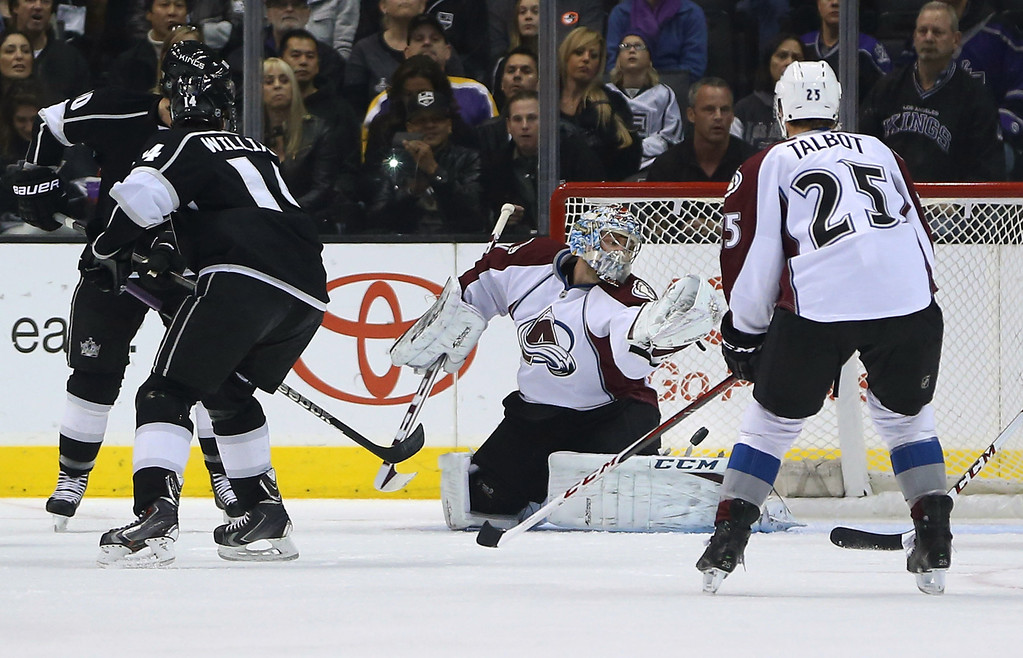 . LOS ANGELES, CA - NOVEMBER 23:  Goaltender Semyon Varlamov #1 of the Colorado Avalanche makes a glove makes a save in the first period during the NHL game against the Los Angeles Kings at Staples Center on November 23, 2013 in Los Angeles, California.  (Photo by Victor Decolongon/Getty Images)