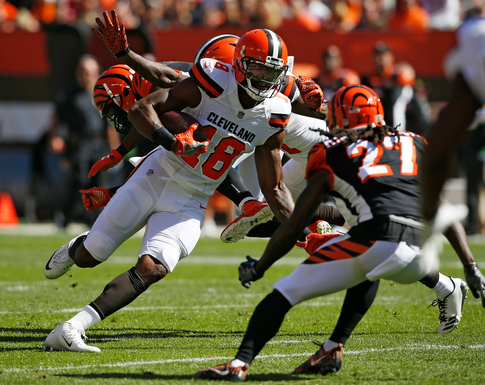 . Cleveland Browns wide receiver Kenny Britt (18) runs the ball in the first half of an NFL football game against the Cincinnati Bengals, Sunday, Oct. 1, 2017, in Cleveland. (AP Photo/Ron Schwane)