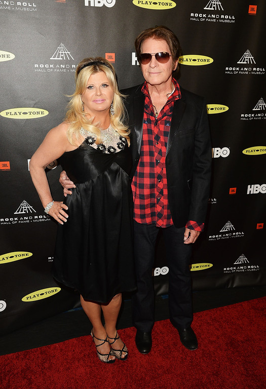 . Musician John Fogerty (R) and Julie Lebiedzinski arrive at the 28th Annual Rock and Roll Hall of Fame Induction Ceremony at Nokia Theatre L.A. Live on April 18, 2013 in Los Angeles, California.  (Photo by Jason Merritt/Getty Images)