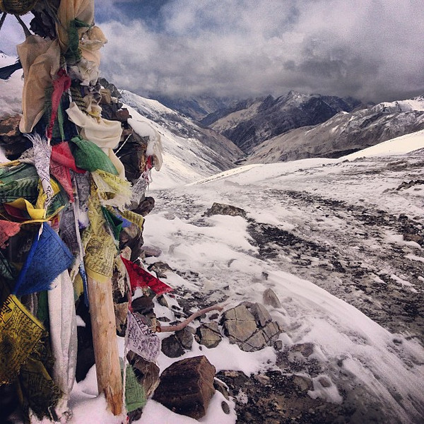 After the snowblinds, Buddhist prayer flags at Ganda La pass (4950m / 16,240 ft). Markha Valley trek, Day 2, nearing midday #harsh