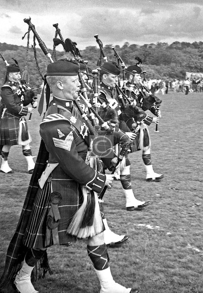 The pipe band were wearing the insignia of the Highland Light Infantry, though the regiment had amalgamated with the Royal Scots Fusiliers in 1959.
