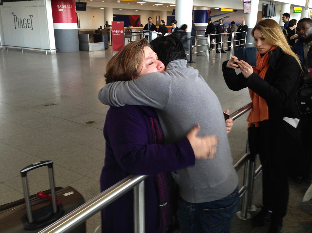 . A woman is embraced by her son-in-law at John F. Kennedy International Airport on Sunday, Jan. 29, 2017, in New York. The son-in-law said that the woman had travelled from Iran and had been detained after arriving. President Donald Trump\'s executive order Friday suspended all immigration and visa processes for nationals from a handful of countries with terrorism concerns, including Iran, for 90 days. (AP Photo/Seth Wenig)