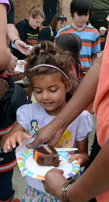 . Children enjoy cake cut for the Fairmount Fire Company 125th Anniversary festivities during the Lansdale Founders Day celebration on Saturday August 23,2014. Photo by Mark C Psoras/The Reporter