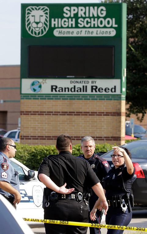 . Law enforcement officers gather outside Spring High School Wednesday, Sept. 4, 2013, in Spring, Texas.  (AP Photo/David J. Phillip)