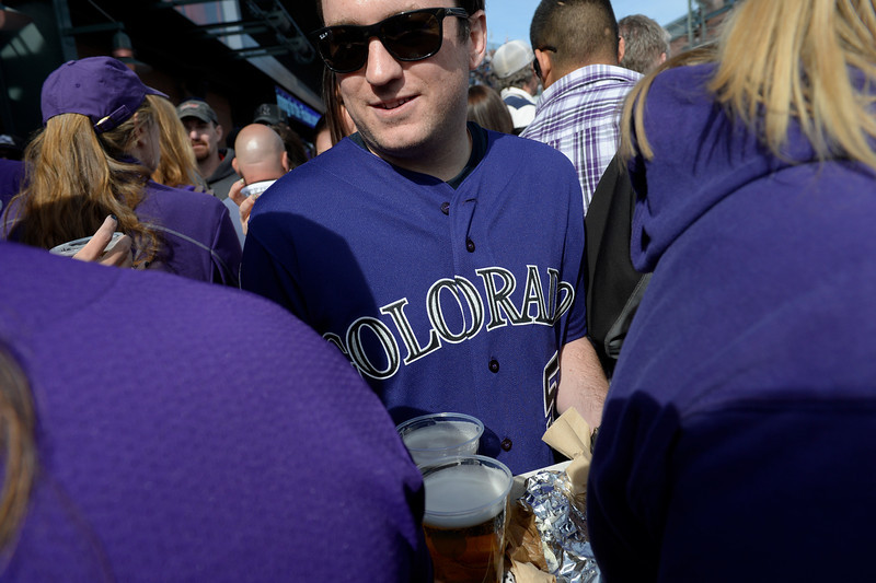 . DENVER, CO. - APRIL 04: A fan carries beer through the crowd during the Colorado Rockies home opener against the Arizona Diamondbacks at Coors Field in Denver, CO April 04, 2014. (Photo By Craig F. Walker / The Denver Post)