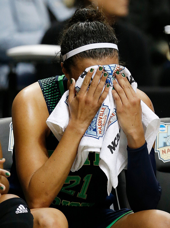 . Notre Dame guard Kayla McBride (21) sits on the bench after the second half of the championship game against Connecticut in the Final Four of the NCAA women\'s college basketball tournament, Tuesday, April 8, 2014, in Nashville, Tenn. Connecticut won 79-58.(AP Photo/Mark Humphrey)