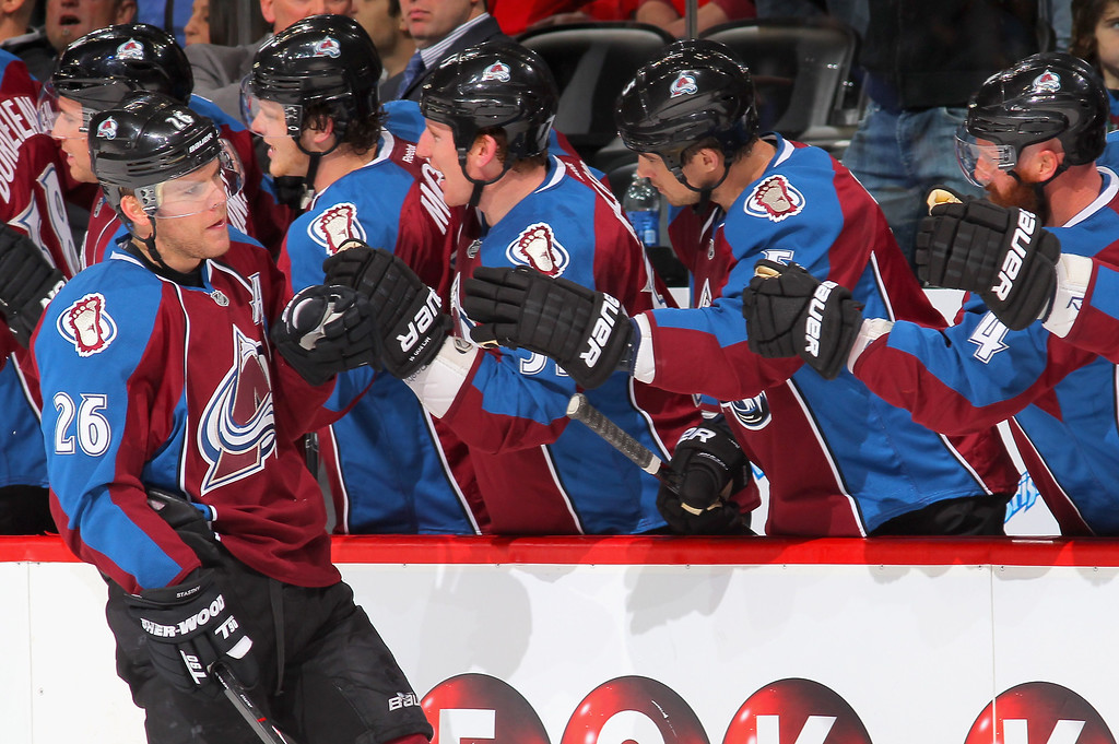 . DENVER, CO - MARCH 08:  Paul Stastny #26 of the Colorado Avalanche celebrates his goal against the Chicago Blackhawks with his teammates as he tied the score 1-1 in the first period at the Pepsi Center on March 8, 2013 in Denver, Colorado.  (Photo by Doug Pensinger/Getty Images)