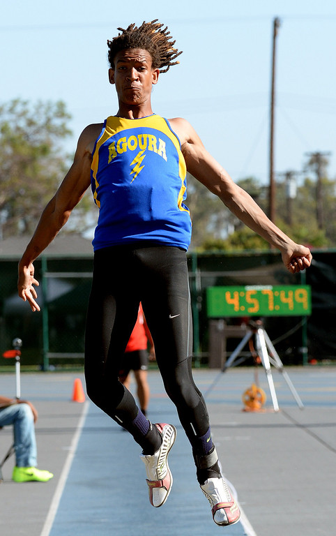 . Agoura\'s Indrees Bernard competes in the long jump during the CIF-SS Masters Track and Field meet at Falcon Field on the campus of Cerritos College in Norwalk, Calif., on Friday, May 30, 2014.   (Keith Birmingham/Pasadena Star-News)
