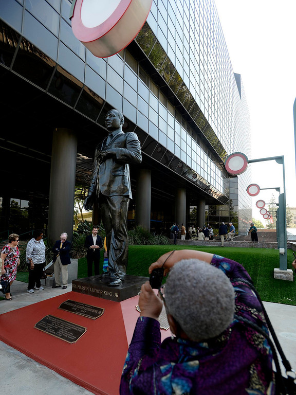 . Community members admire the newly restored Martin Luther King, Jr. statue in downtown San Bernardino April 12, 2013.  GABRIEL LUIS ACOSTA/STAFF PHOTOGRAPHER.
