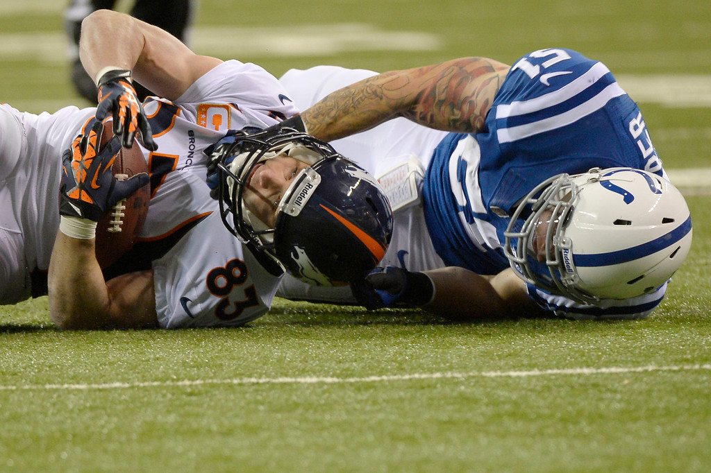 . Wide receiver Wes Welker (83) of the Denver Broncos is tackles by inside linebacker Pat Angerer (51) of the Indianapolis Colts at Lucas Oil Stadium. October 20, 2013 Indianapolis, Indiana. (Photo By Joe Amon/The Denver Post)