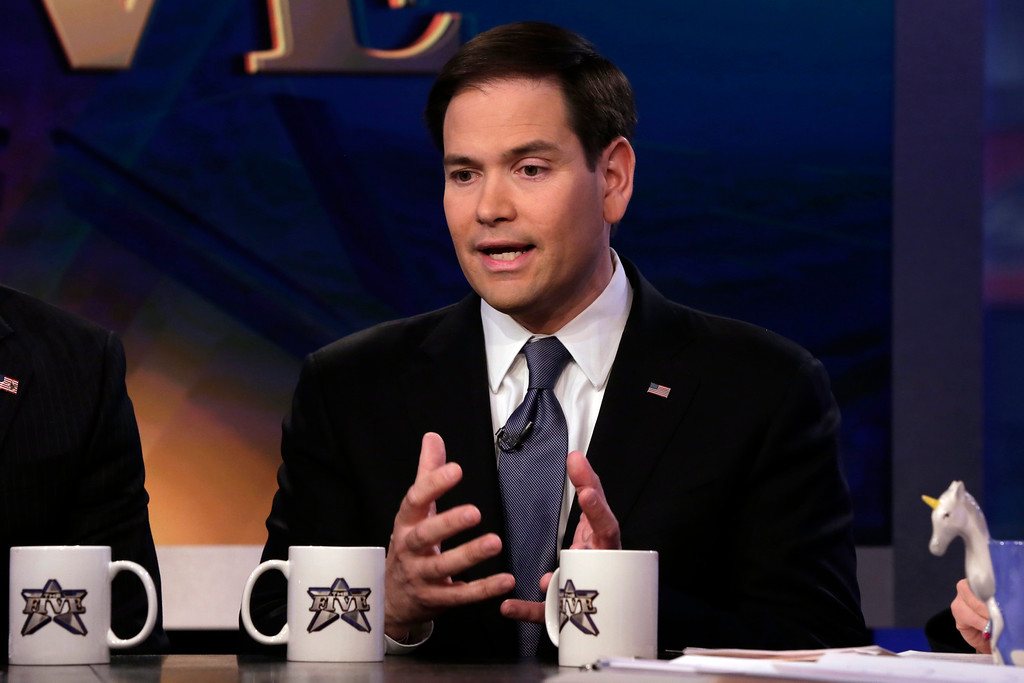 ". FILE - In this March 30, 2015 file photo, U.S. Sen. Marco Rubio, R-Fla, appears on ""The Five\"" television program, on the Fox News Channel, in New York. Rubio�s expected entry into the presidential race will set off a series of announcements by other Florida politicians from both parties who want to replace him.  Rubio plans to announce his future political plans Monday, April 13, 2015,  at the Freedom Tower in Miami.  (AP Photo/Richard Drew)"