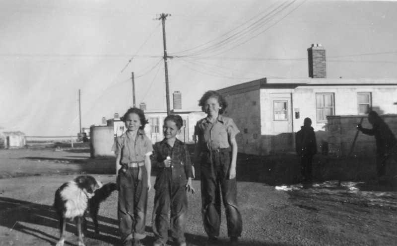 Cherry, George and Carol Burgin with their dog Shep in Cheyenne, Wyoming 1940's