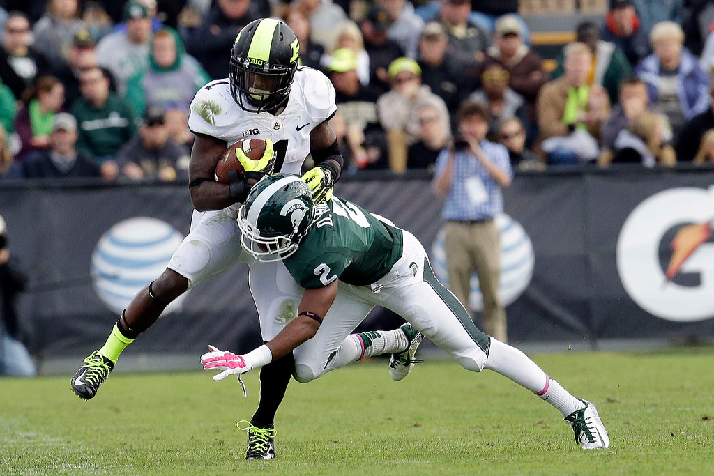 . Purdue running back Akeem Hunt (1) is tackled by Michigan State cornerback Darian Hicks (2) during the second half of an NCAA college football game in West Lafayette, Ind., Saturday, Oct. 11, 2014. Michigan State won 45-31. (AP Photo/AJ Mast)
