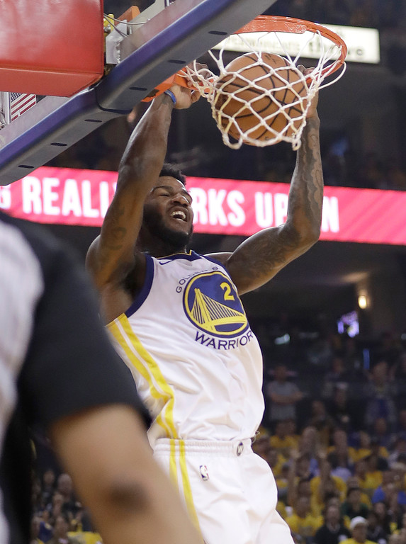 . Golden State Warriors forward Jordan Bell (2) dunks against the Cleveland Cavaliers during the first half of Game 1 of basketball\'s NBA Finals in Oakland, Calif., Thursday, May 31, 2018. (AP Photo/Marcio Jose Sanchez)