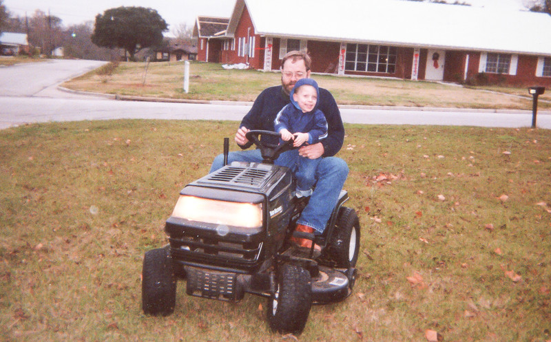 Jim and EJ on Lawn Tractor Christmas 2000 1446 14th Street Hempstead, Texas