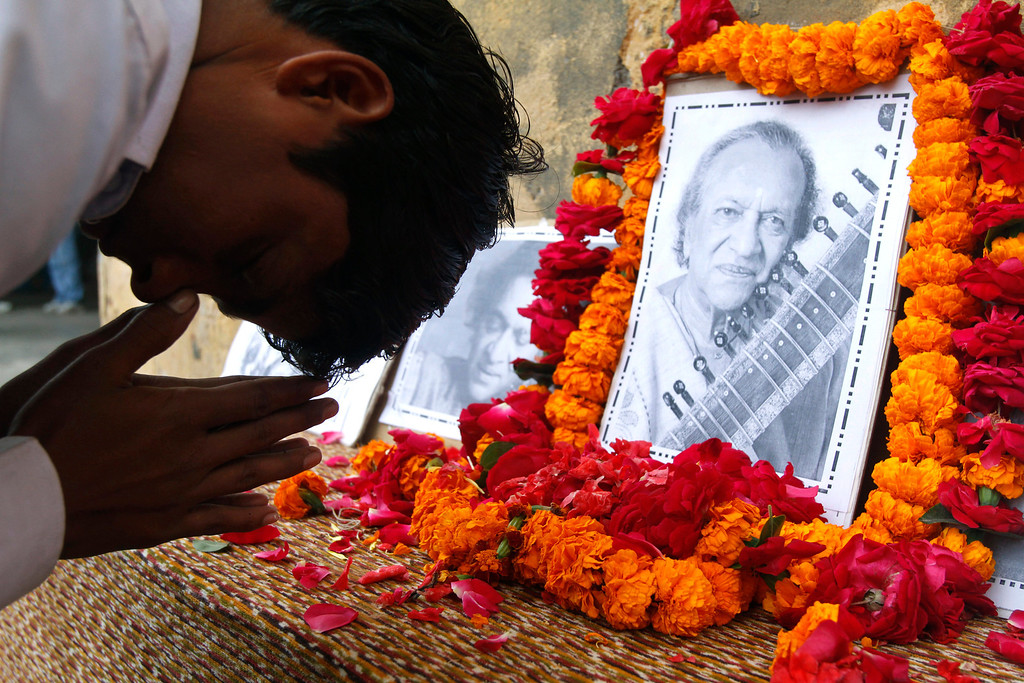 . A student pays tribute to legendary Indian sitar player Ravi Shankar at the Bengali Tola Inter College, where Shankar had studied in Varanasi, India, Wednesday, Dec. 12, 2012. Shankar, who is credited with connecting the world to Indian music, died Tuesday in San Diego at the age of 92. (AP Photo/Rajesh Kumar Singh)