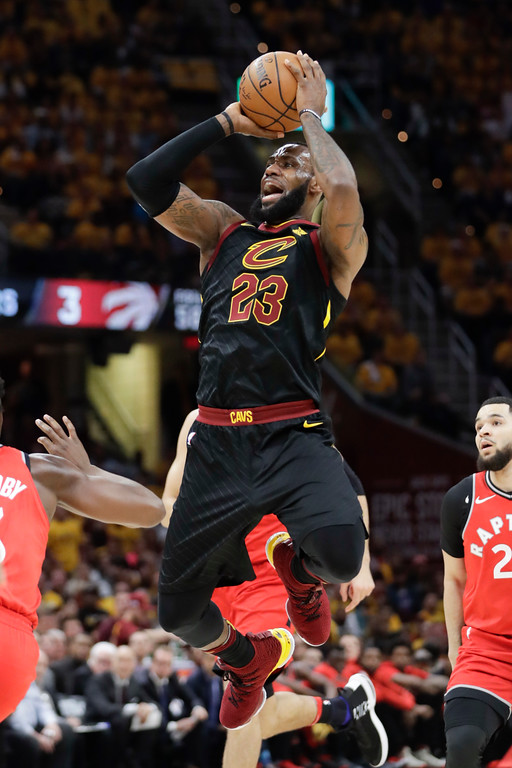 . Cleveland Cavaliers\' LeBron James (23) goes up for a shot against the Toronto Raptors in the first half of Game 4 of an NBA basketball second-round playoff series, Monday, May 7, 2018, in Cleveland. (AP Photo/Tony Dejak)