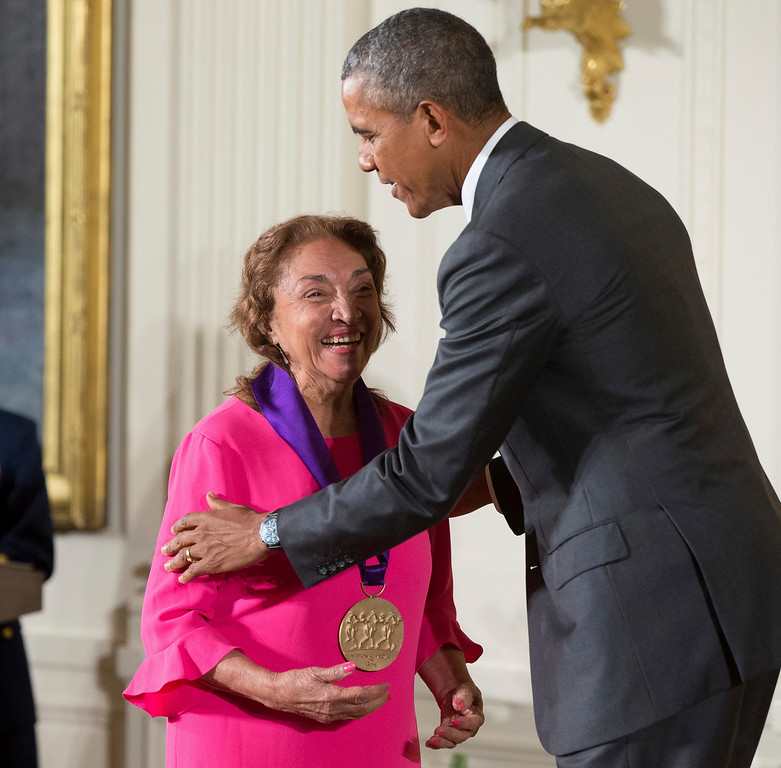 . FILE - In this Sept. 10, 2015, file photo, President Barack Obama awards the 2014 National Medal of Arts to actress, theater founder, and director Miriam Colon of New York during a ceremony in the East Room at the White House in Washington. Colon, an icon in U.S. Latino theater who starred in films alongside Marlon Brando and Al Pacino, has died at age 80. Her husband, Fred Valle, told The Associated Press that Colon died early Friday, March 3, 2017, because of complications from a pulmonary infection. (AP Photo/Andrew Harnik, File)