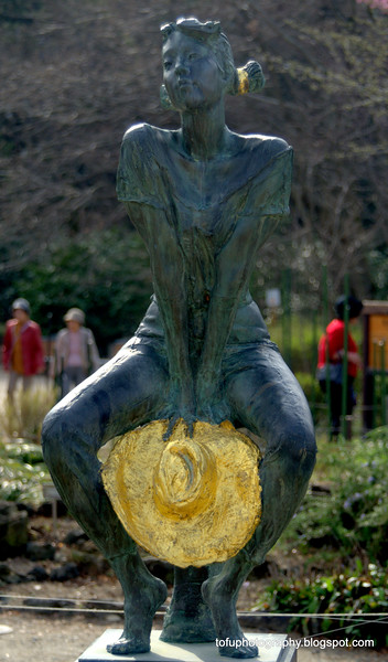 Sculpture of a woman with a hat at the botanical gardens in Kyoto, Japan in March 2015