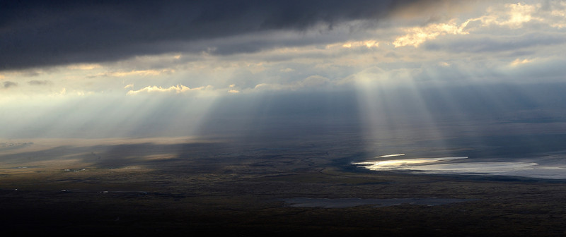 The sky opens up on the Ngorongoro Crater, one cloudy morning.......