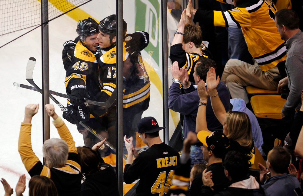 Description of . Boston Bruins Milan Lucic (R) celebrates his goal against the New York Rangers with Bruins teammate David Krejci during the first period of their NHL hockey game at TD Garden in Boston, Massachusetts January 19, 2013. REUTERS/Jessica Rinaldi