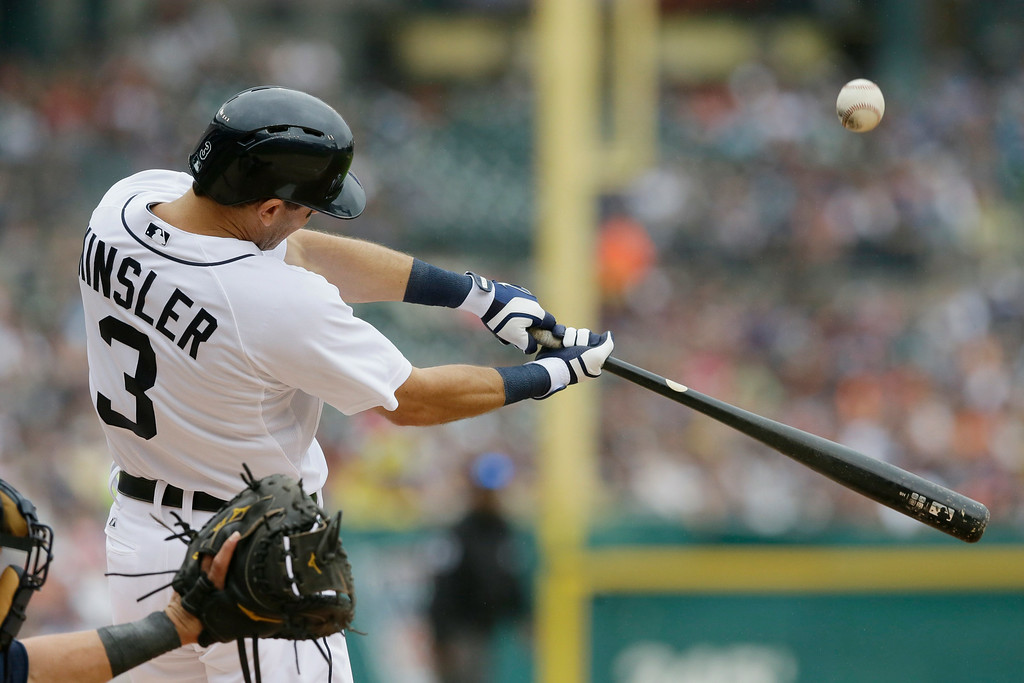 . Detroit Tigers\' Ian Kinsler bats during the third inning in the first baseball game of a doubleheader against the Cleveland Indians, Saturday, July 19, 2014 in Detroit. (AP Photo/Carlos Osorio)
