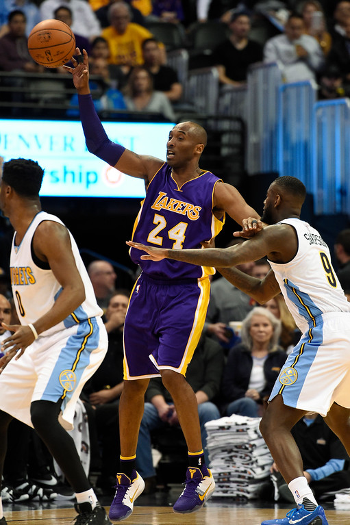 . DENVER, CO - MARCH 02: Los Angeles Lakers forward Kobe Bryant (24) gets the pass in front of Denver Nuggets guard JaKarr Sampson (9) March 2, 2016 at Pepsi Center. This is Kobe\'s last game in Denver as he retires at the end of the season. (Photo By John Leyba/The Denver Post)