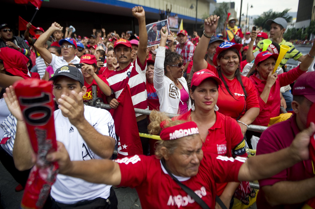 . Supporters of Venezuelan President Nicolas Maduro cheer in front of the National Assembly during his inauguration in Caracas on April 19, 2013.  RAUL ARBOLEDA/AFP/Getty Images