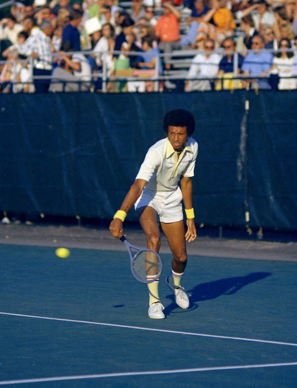 . Arthur Ashe, second seeded tennis player backhands a shot, July 24, 1973, at Longwood Cricket Club in Brookline, Massachusetts. He lost the match to Jimmy Connors and the $12,000 first place money. (AP Photo/J. Walter Green)