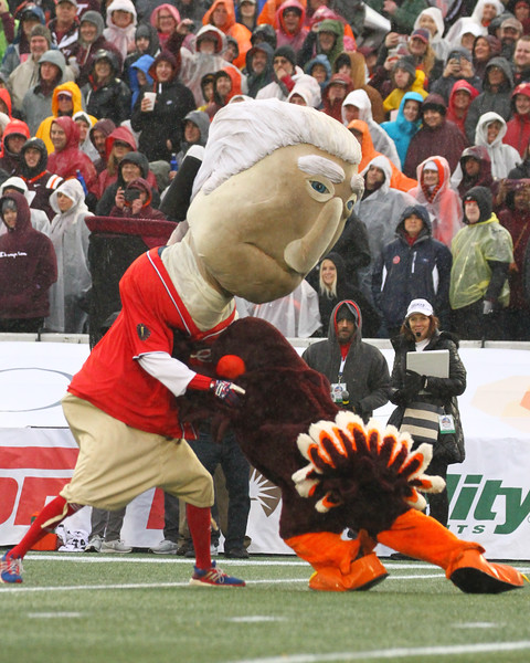 The Washington Nationals Racing Presidents appeared and tried to run the ball the length of the field against the VA Tech and Cincinnati mascots.  George laid a solid block on the HokieBird